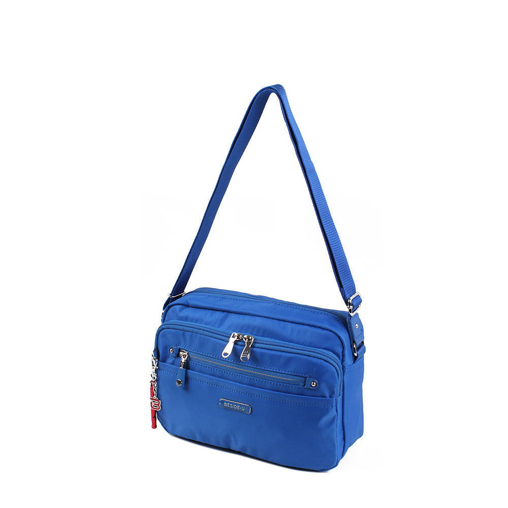 Crossbody Bag - Baker Leather Trimmed Medium Crossbody Bag With Red Whistle Angled [Strong Blue]