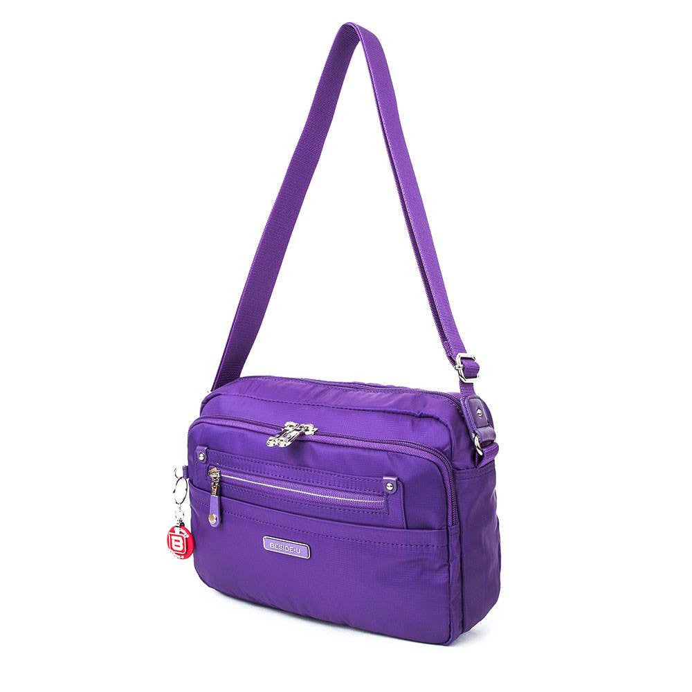 Crossbody Bag - Baker Leather Trimmed Medium Crossbody Bag With Round Dangle Angled [Majesty Purple]