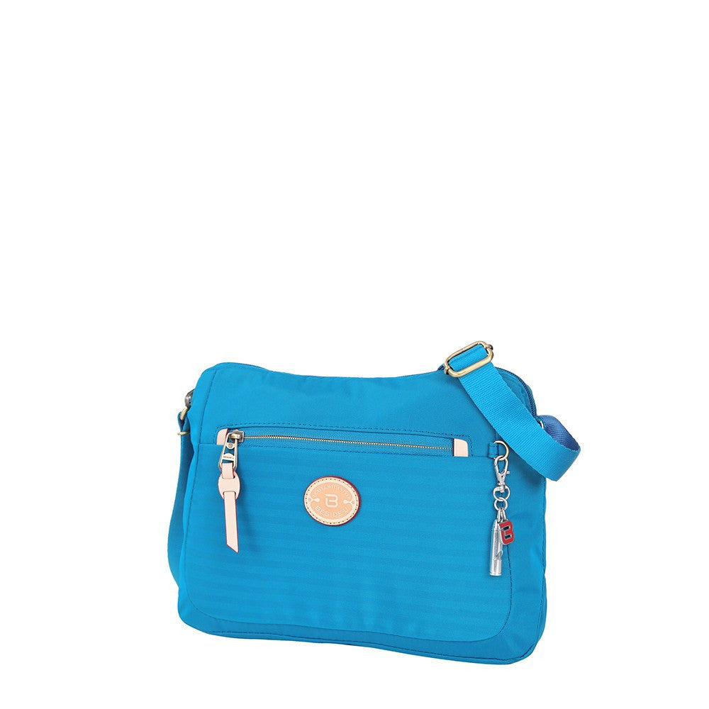 Crossbody Bag - Bali Leather Trimmed Casual Crossbody Bag Angled [Cowboy Blue]