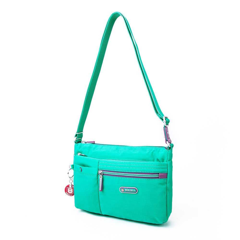 Crossbody Bag - Cimarron Two-Tone Small Crossbody Bag Angled [Atlantis Teal Blue]