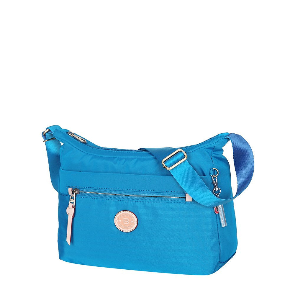 Crossbody Bag - Flores Leather Trimmed Travel Crossbody Bag Angled [Cowboy Blue]