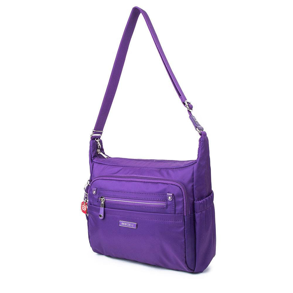 Crossbody Bag - Grenada Leather Trimmed Multi-Pocket Crossbody Bag With Round Dangle Angled [Majesty Purple]