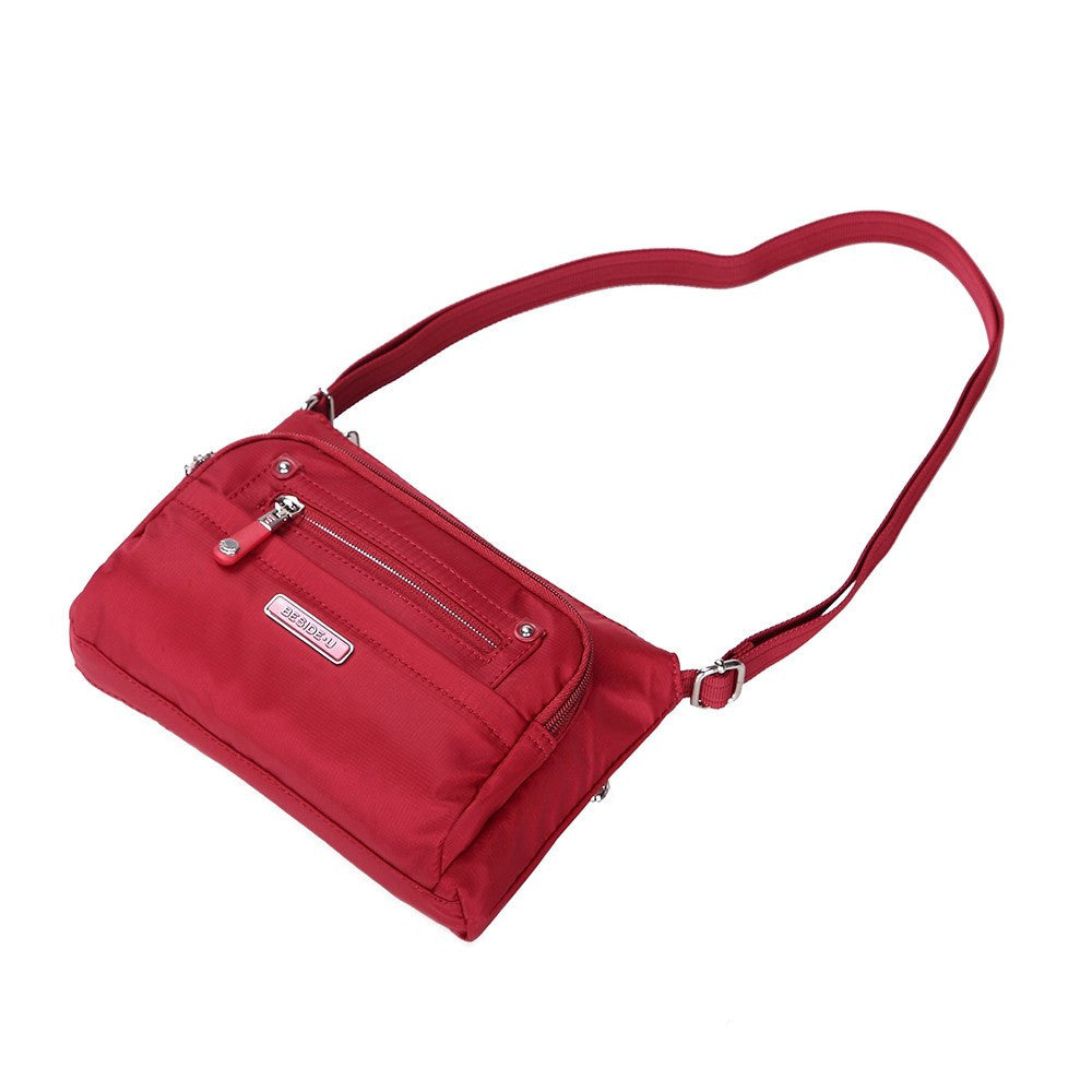 Crossbody Bag - Hemet Leather Trimmed Small Travel Crossbody Bag Lying Down [Jester Red]