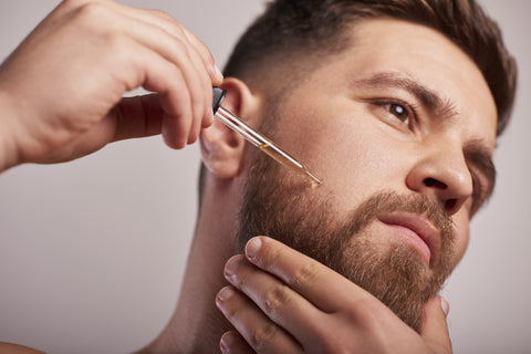 beard oil being applied at home