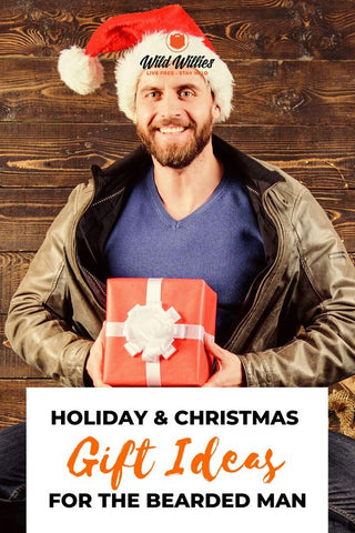 Bearded Man Holding a Christmas Present | Gifts to Give Bearded Men
