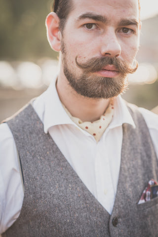 young man with a handlebar mustache