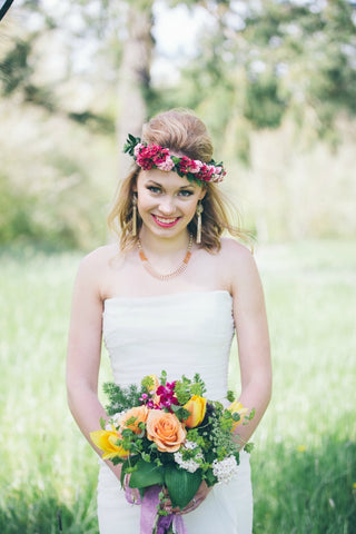 bride with bouquet and flower crown