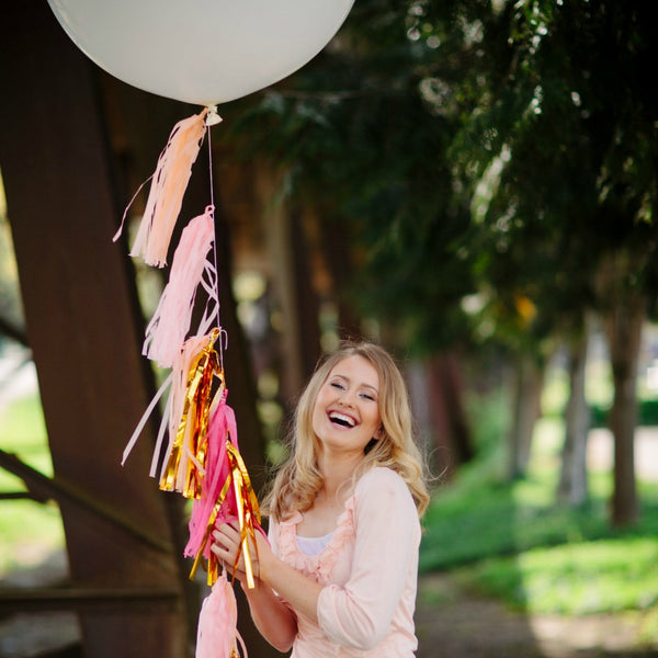 pink and gold balloon tassels