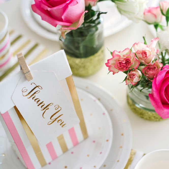 pink and gold favor bags