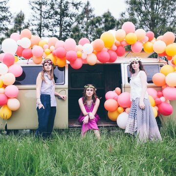 pink boho wedding arch on bus