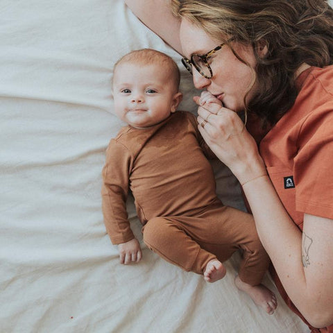 gender neutral newborn baby clothes in black or camel tan