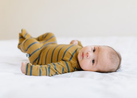 Striped Newborn Romper with Baby Laying Down