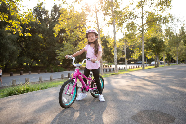 "Little girl on a pink 16"" Guardian Bike"