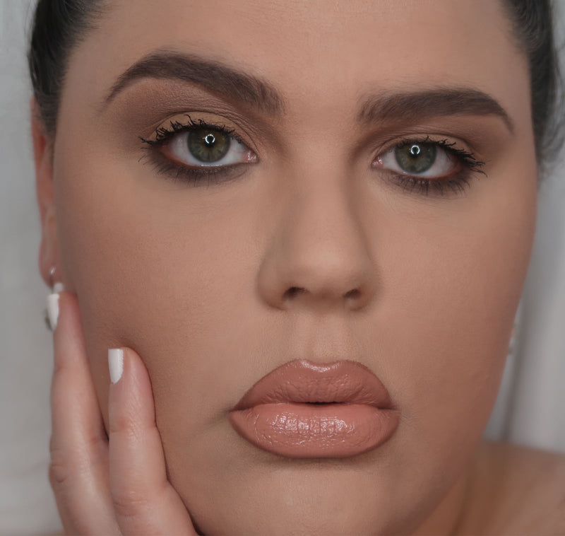 woman wearing beige liquid lipstick