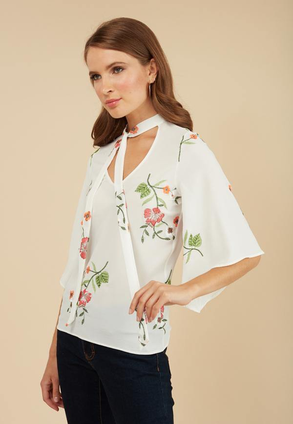 Kay Celine Top Floral Embroidered Tie Neck Top in Off White