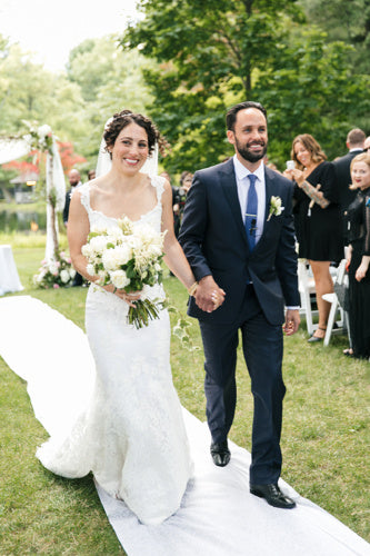 Bride-groom-holding-hands-down-aisle