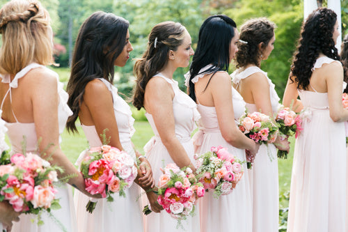 bridesmaids-wedding-ceremony-pink-roses