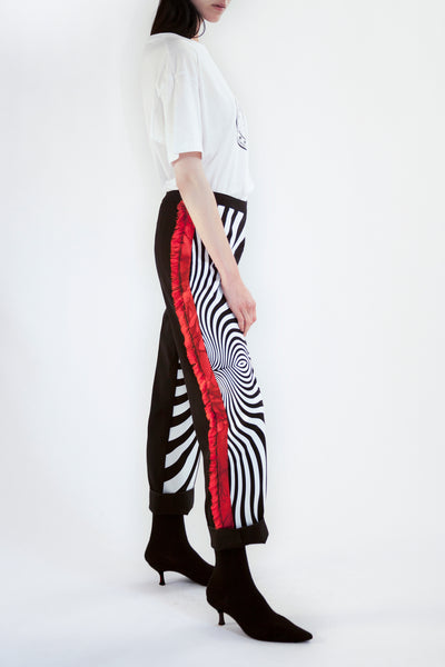 tapered pants with psychedelic front print and fringed side seam