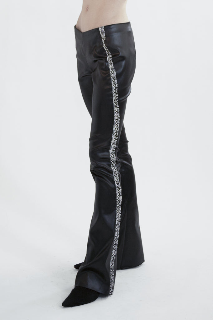 flared faux leather pants in liquid acetate
