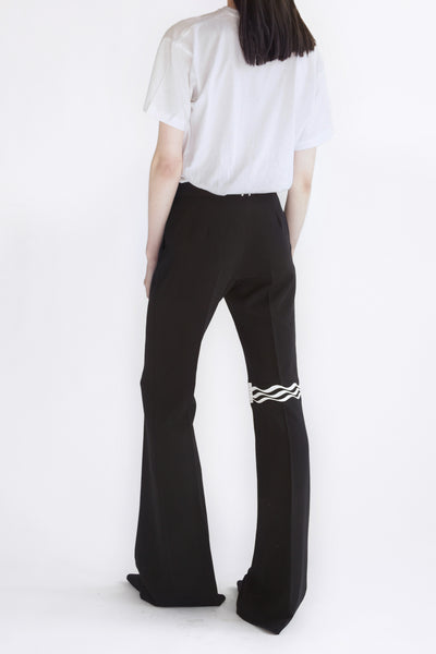 classic flared pants with printed knee detail