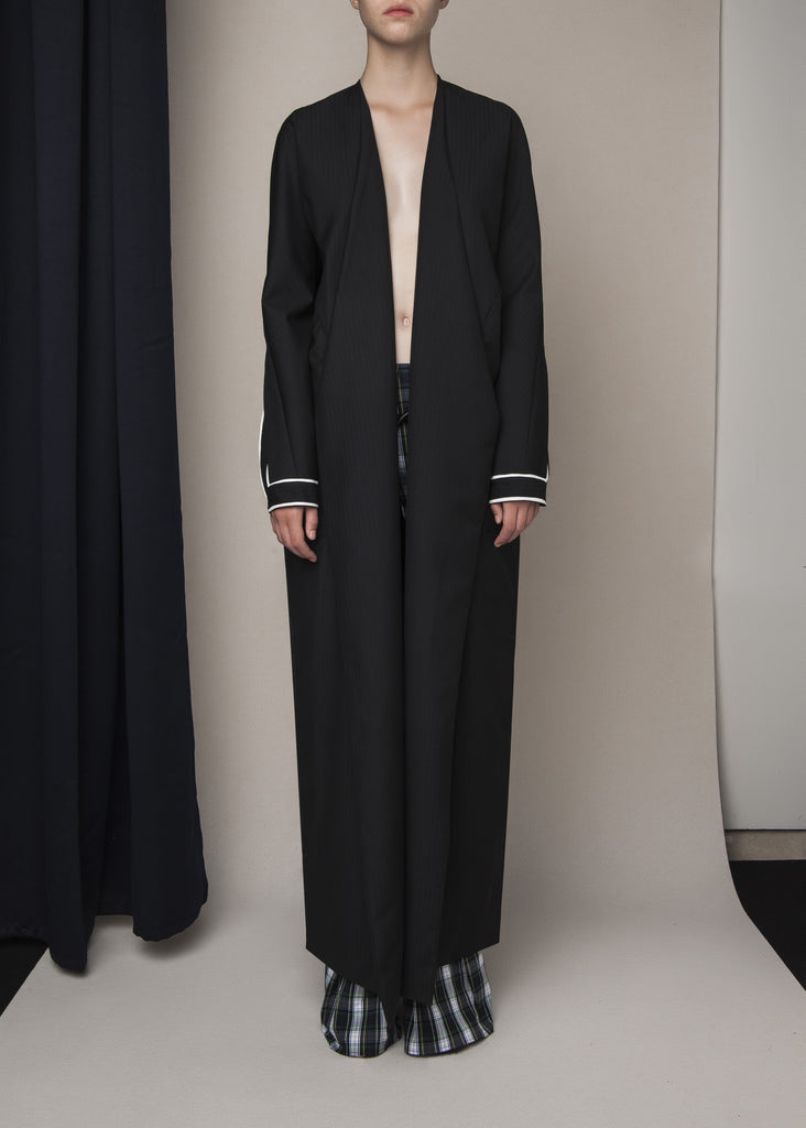 long pinstripe coat in black wool with designed sleeves