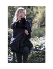 Black evening shawl with fur trim, in cashmere wool, worn as a pashmina wrap