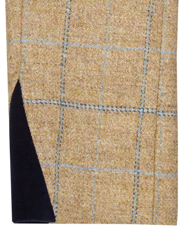 velvet cuff detail on long wool tweed coat