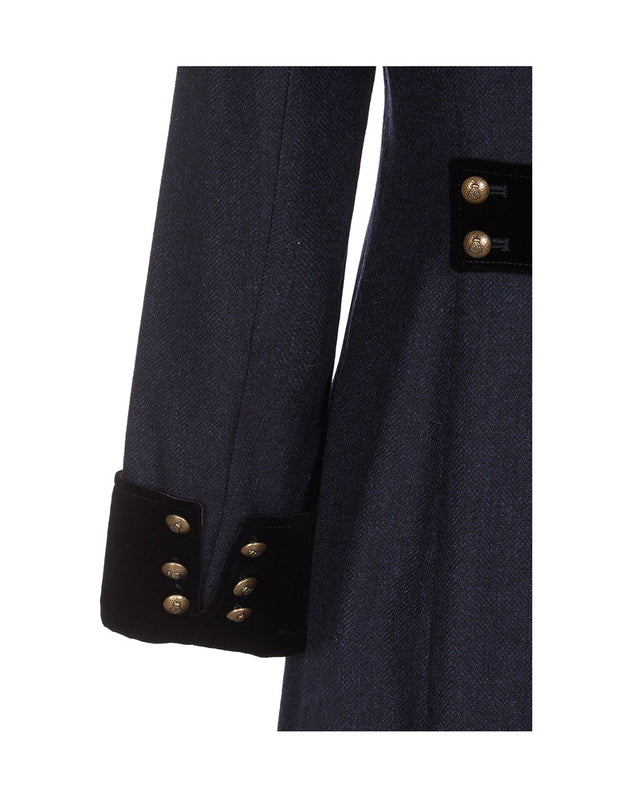 Long navy wool coat sleeve detail with velvet cuff and military buttons