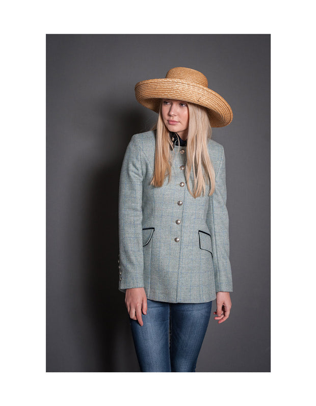 Green tweed womens tailored jacket worn with jeans and hat