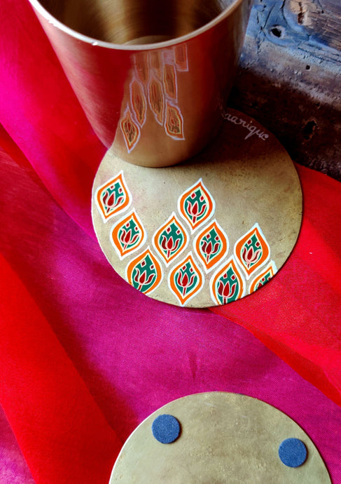 Handpainted Jali brass coasters . Set of 4