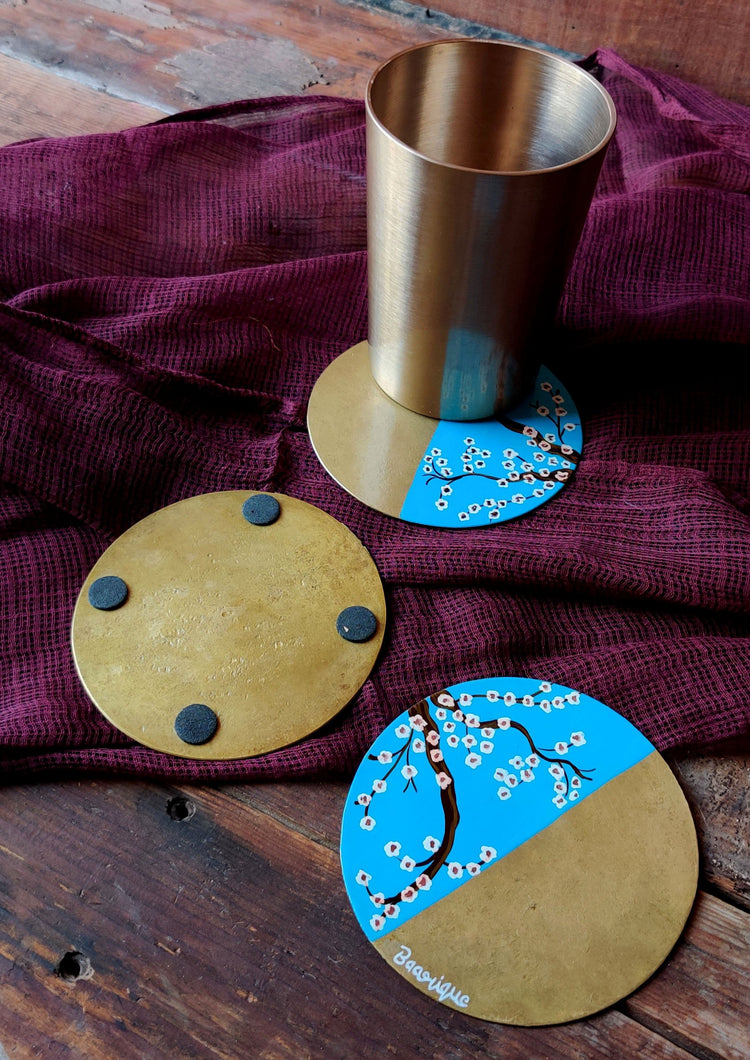 Handpainted White cherry blossom brass coasters . Set of 4
