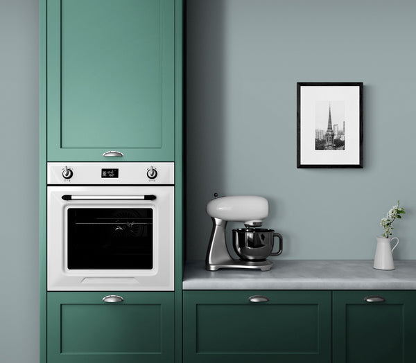 """Amidst a Changing Skyline"" framed in a modern, but retro-styled kitchen."