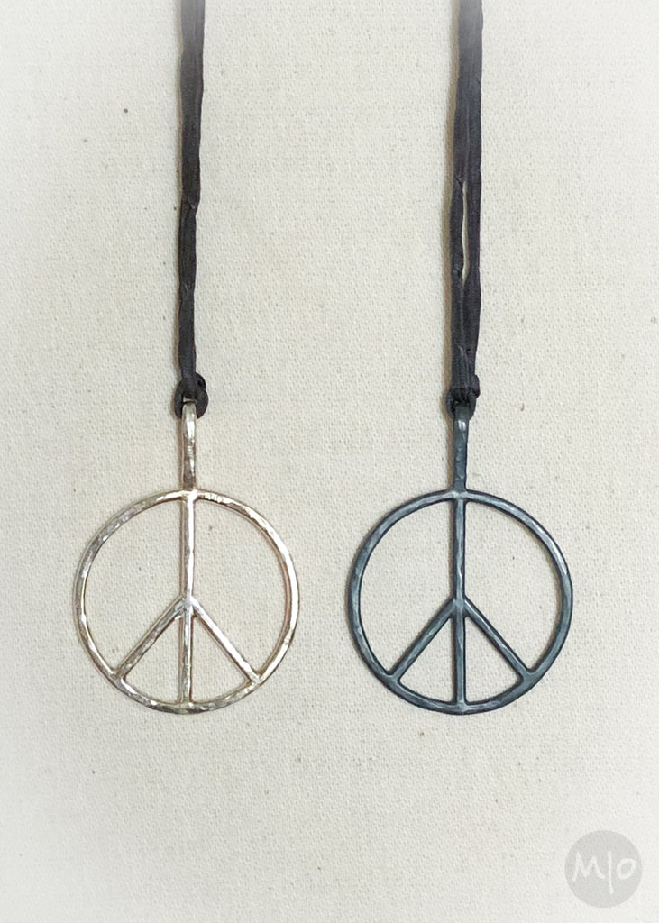 Peace pendants in sterling silver at Melissa Osgood Studio.