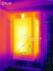 Showing heat loss from old boiler about to be replaced and temperature emitting