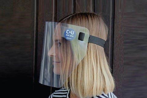 Side view of a model wearing PET Protective Face Shield with Elastic Band in black