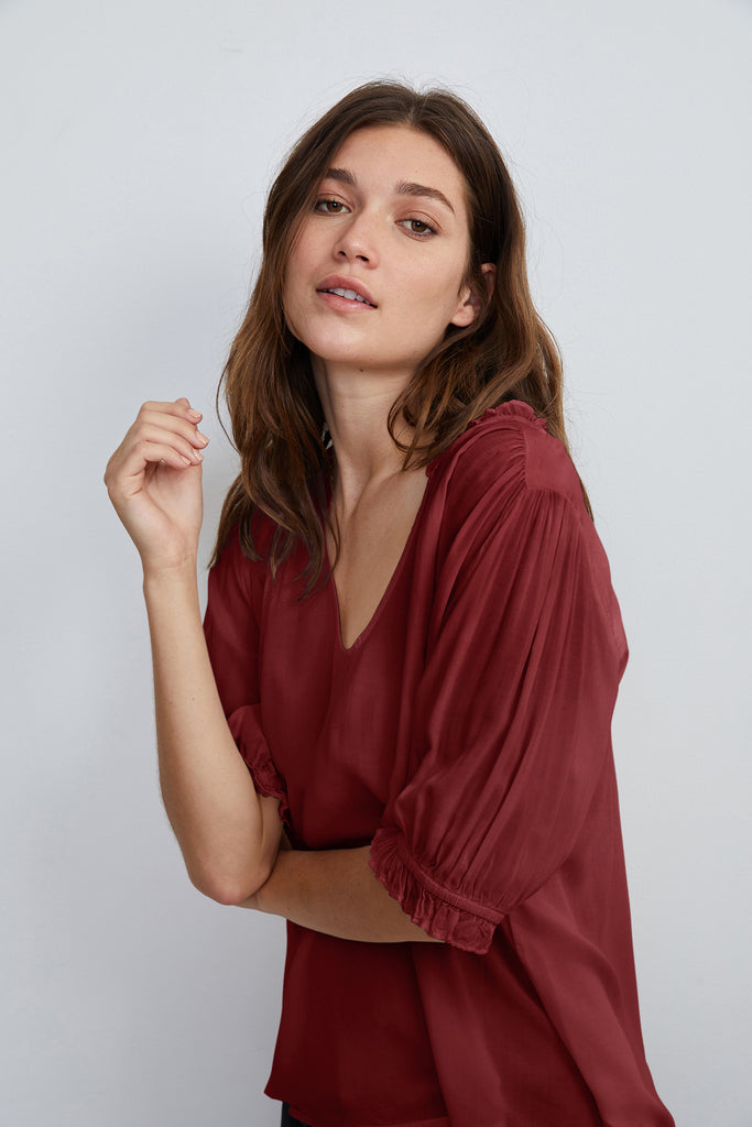 TRIXIE RUFFLED BLOUSE IN MARSALA