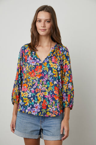 TYRA PRINTED PEASANT BLOUSE IN NAVY FLORAL