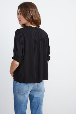 TRIXIE RUFFLED BLOUSE IN BLACK