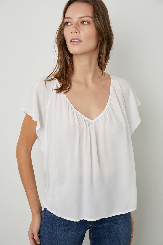 LYANNA FLUTTER SLEEVE BLOUSE IN WHITE