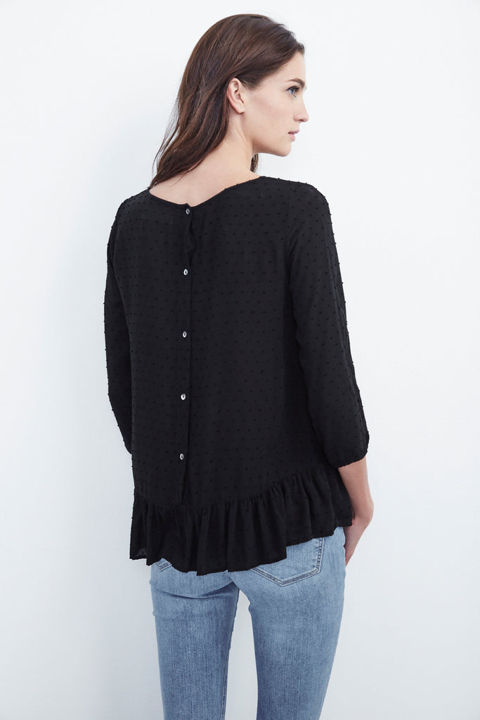 DORI SWISS DOT RUFFLE TOP IN BLACK