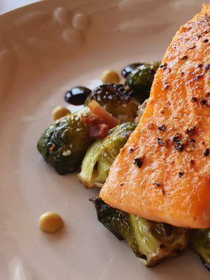 Pan Seared Salmon & Charred Brussels sprouts w/ Goat Cheese, Pancetta, & Fig Balsamic