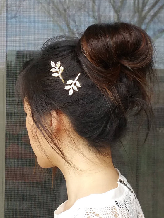 Woman wearing leaves hair bobby pins for a wedding