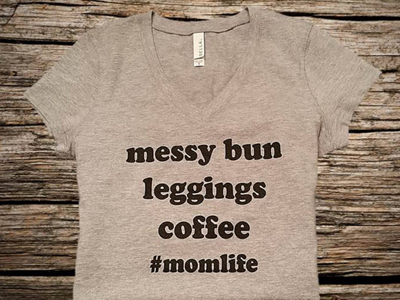 Woman wearing a messy bun hair tee shirt