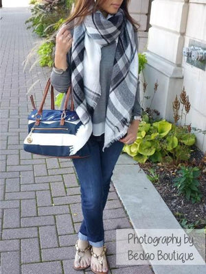Woman wearing a blanket zara scarf