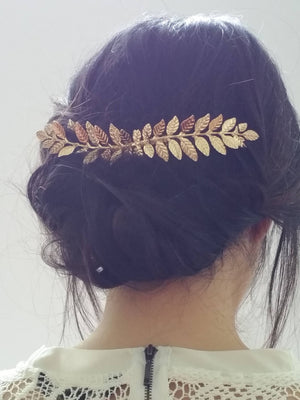 Bride wearing a long laurel leaf hair comb for a wedding