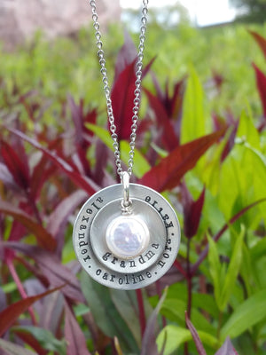 Personalized circle pendants with a round freshwater pearl necklace for mom