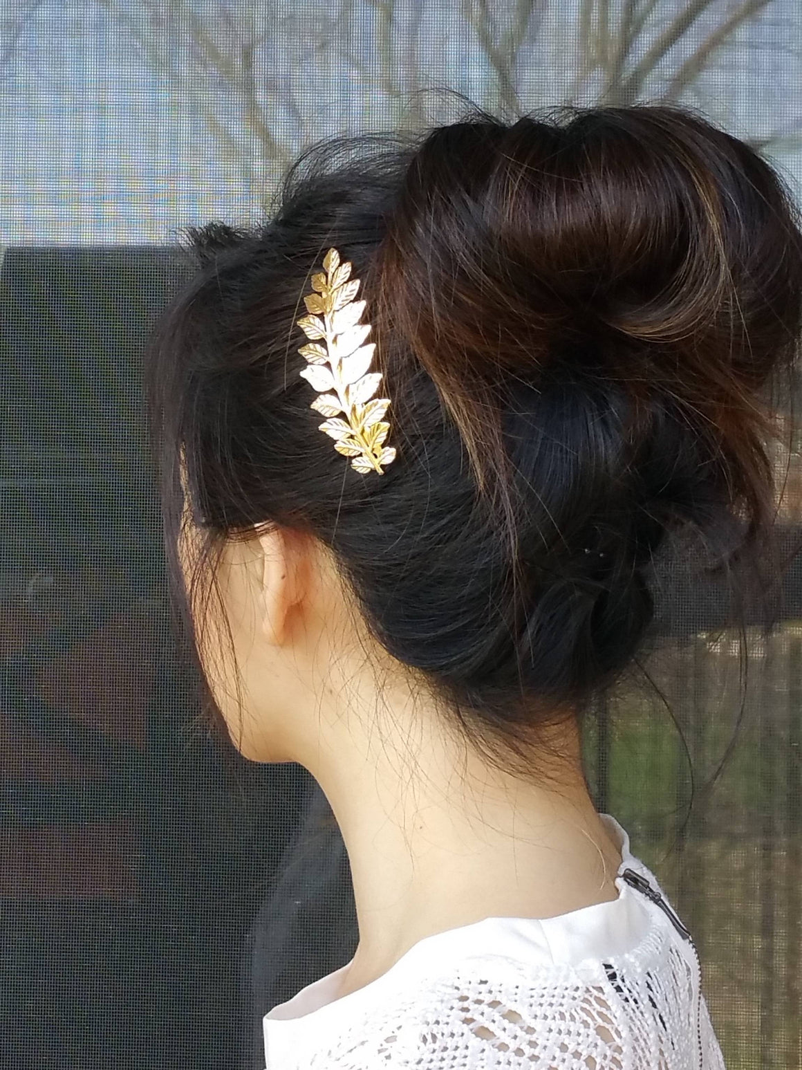 Woman wearing a laurel leaf hair barrette for a wedding