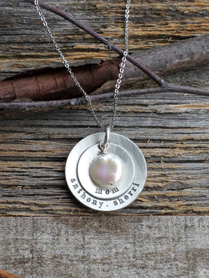 Personalized circle pendants with a round freshwater pearl necklace for mom or grandma