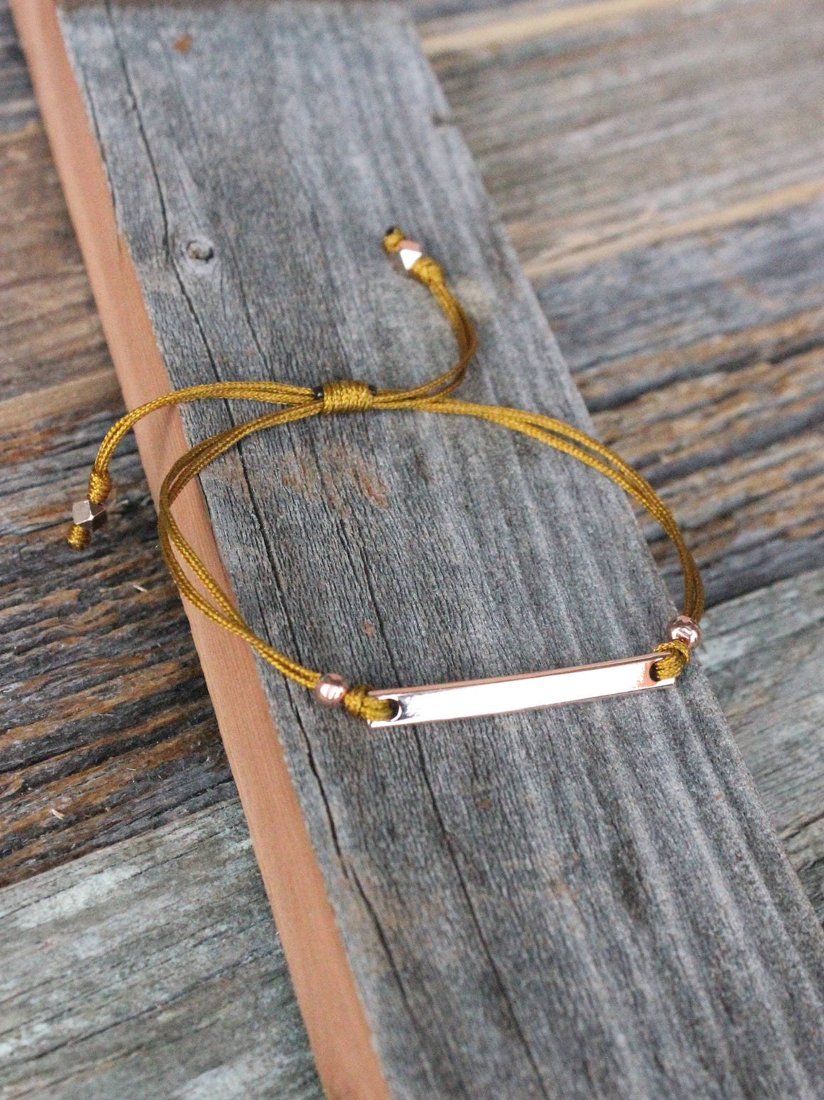 Dainty rose gold personalized bracelet with mustard nylon cord