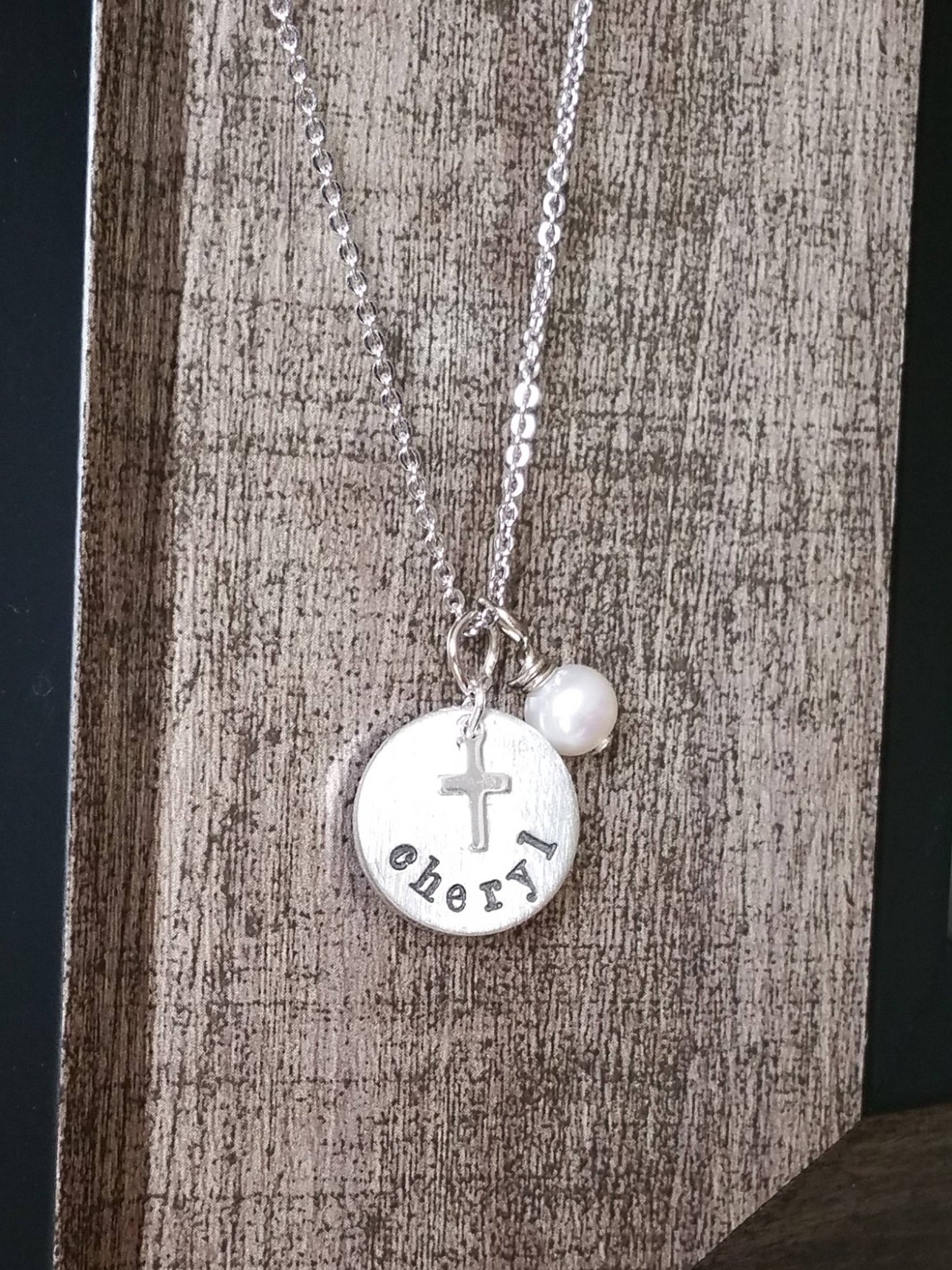 Personalized circle pendant with a sterling silver cross charm and pearl necklace